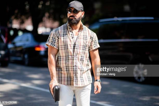 A guest wearing Burberry button shirt is seen outside M1992 during Milan Men's Fashion Week Spring/Summer 2019 on June 16 2018 in Milan Italy