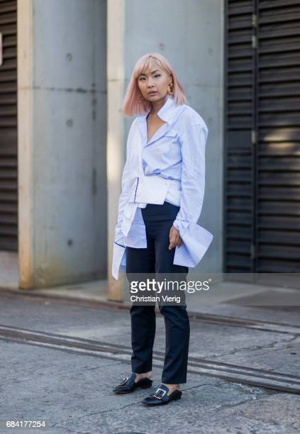 A guest wearing button shirt at day 4 during MercedesBenz Fashion Week Resort 18 Collections at Carriageworks on May 17 2017 in Sydney Australia