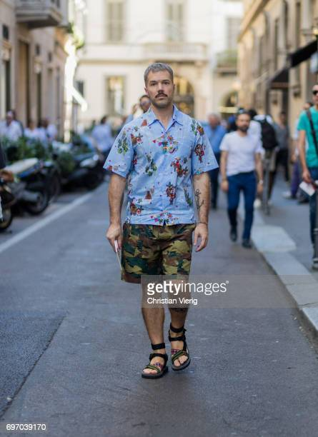 A guest wearing camouflage shirts and sandals is seen outside Versace during Milan Men's Fashion Week Spring/Summer 2018 on June 17 2017 in Milan...