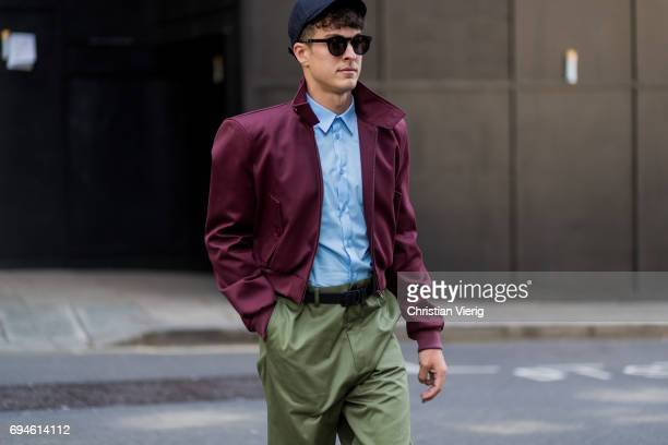 A guest wearing cap and bomber jacket during the London Fashion Week Men's June 2017 collections on June 10 2017 in London England