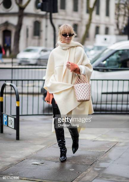 A guest wearing cape seen outside Eudon Choi during London Fashion Week February 2018 on February 20 2018 in London England