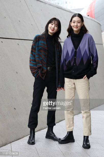 Guest wearing cardigan and cotton pants with black leather ankle boots is seen at the Hera Seoul Fashion Week 2019 F/W at Dongdaemun Design Plaza at...
