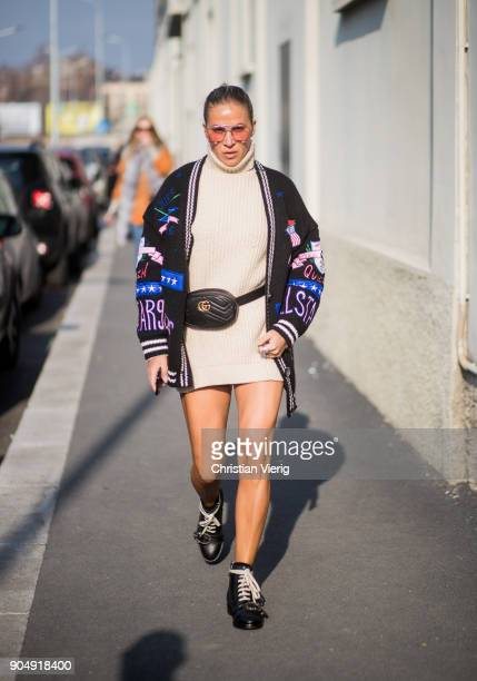 A guest wearing cardigan Gucci belt creme turtleneck knit is seen outside DSquared2 during Milan Men's Fashion Week Fall/Winter 2018/19 on January 14...