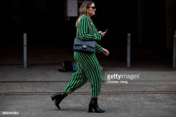 A guest wearing Chanel bag green striped suit during MercedesBenz Fashion Week Resort 19 Collections at Carriageworks on May 14 2018 in Sydney...