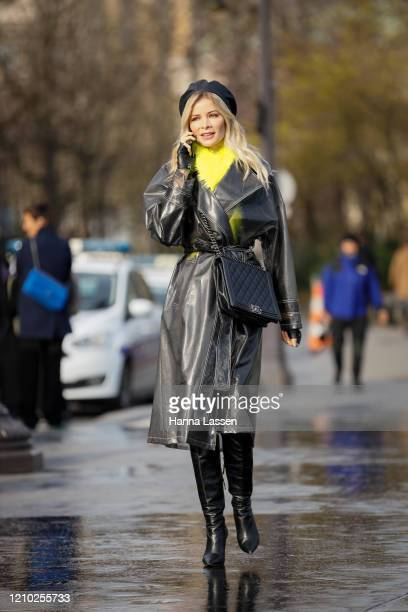 Guest wearing Chanel bag, leather trench and beret outside the Chanel show during Paris Fashion Week Womenswear Fall/Winter 2020/2021 Day Nine on...