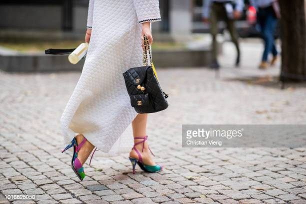 A guest wearing Chanel bag seen outside Anne Karine Thorbjornsen during Oslo Runway SS19 on August 14 2018 in Oslo Norway