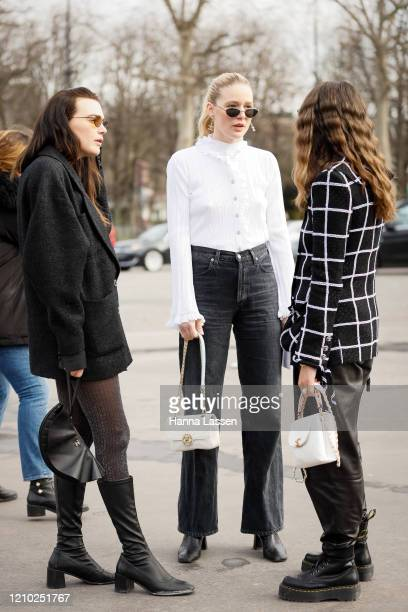 Guest wearing Chanel bag white shirt and denim outside Paris Fashion Week Womenswear Fall/Winter 2020/2021 Day Nine on March 03, 2020 in Paris,...
