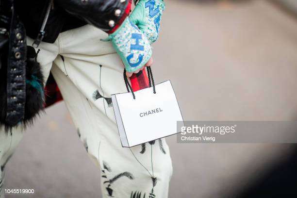 A guest wearing Chanel gloves Chanel shopping bag is seen outside Chanel during Paris Fashion Week Womenswear Spring/Summer 2019 on October 2 2018 in...
