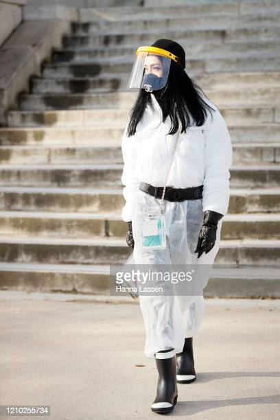 Guest wearing Chanel mask, nelt and bag outside the Chanel show during Paris Fashion Week Womenswear Fall/Winter 2020/2021 Day Nine on March 03, 2020...