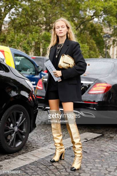 A guest wearing Chanel outside Chanel during Paris Fashion Week Womenswear Spring Summer 2020on October 01 2019 in Paris France