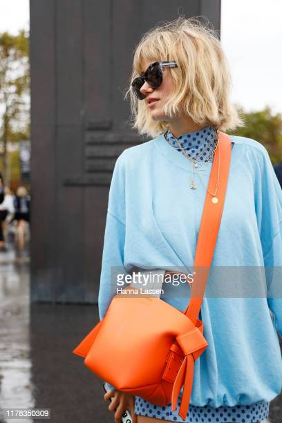 A guest wearing Chanel outside Chanel during Paris Fashion Week Womenswear Spring Summer 2020 on October 01 2019 in Paris France