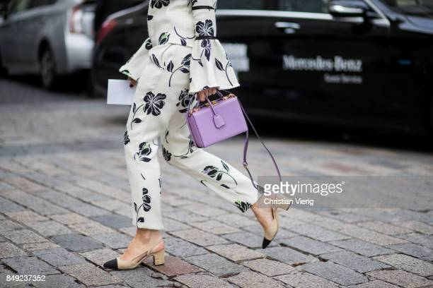 A guest wearing Chanel shoes pink bag outside Emilia Wickstead during London Fashion Week September 2017 on September 18 2017 in London England
