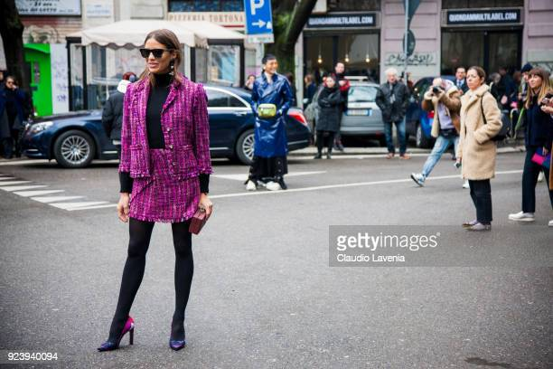 Guest wearing Chanel tailleur is seen outside Giorgio Armani show during Milan Fashion Week Fall/Winter 2018/19 on February 24 2018 in Milan Italy