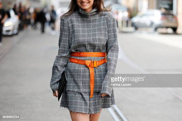 A guest wearing check dress and OffWhite belt during MercedesBenz Fashion Week Resort 19 Collections at Carriageworks on May 16 2018 in Sydney...