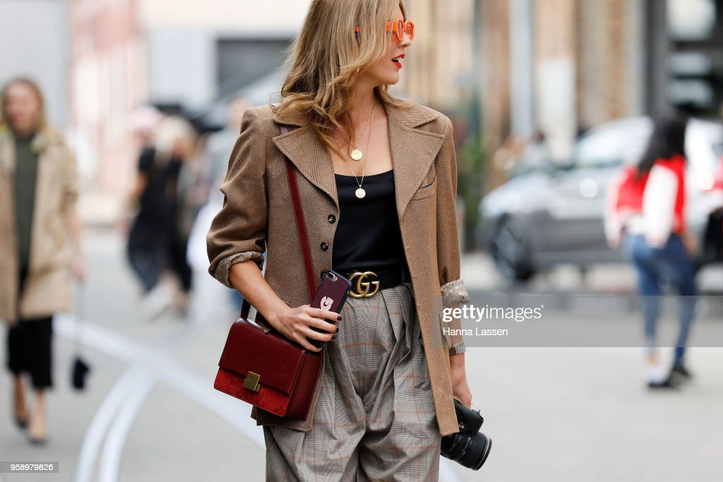 A guest wearing check jacket and pants with Gucci belt during Mercedes-Benz Fashion Week Resort 19 Collections at Carriageworks on May 16, 2018 in Sydney, Australia.