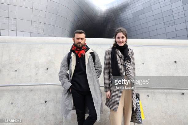 Guest wearing check trench coat and a Coach mini bag is seen at the Hera Seoul Fashion Week 2019 F/W at Dongdaemun Design Plaza at Dongdaemun Design...