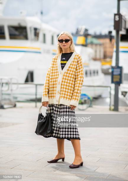 A guest wearing checked cardigan during Stockholm Runway SS19 on August 30 2018 in Stockholm Sweden