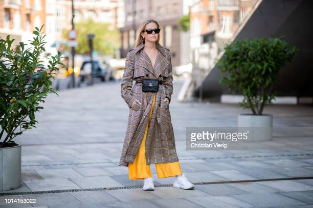 A guest wearing checked coat belt bag is seen outside Designers Remix during the Copenhagen Fashion Week Spring/Summer 2019 on August 9 2018 in...