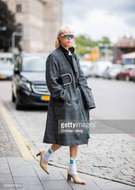 A guest wearing checked grey coat socks with Sweden flag during Stockholm Runway SS19 on August 30 2018 in Stockholm Sweden