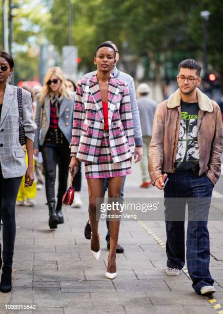A guest wearing checked pink blazer and mini skirt is seen outside ALEXACHUNG during London Fashion Week September 2018 on September 15 2018 in...