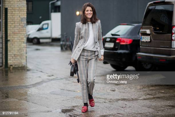 A guest wearing checked suit outside Cecilie Bahnsen during the Copenhagen Fashion Week Autumn/Winter 18 on January 31 2018 in Copenhagen Denmark