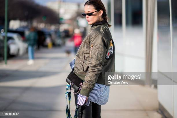 A guest wearing Chloe bag bomber jacket seen outside Creatures of Comfort on February 8 2018 in New York City
