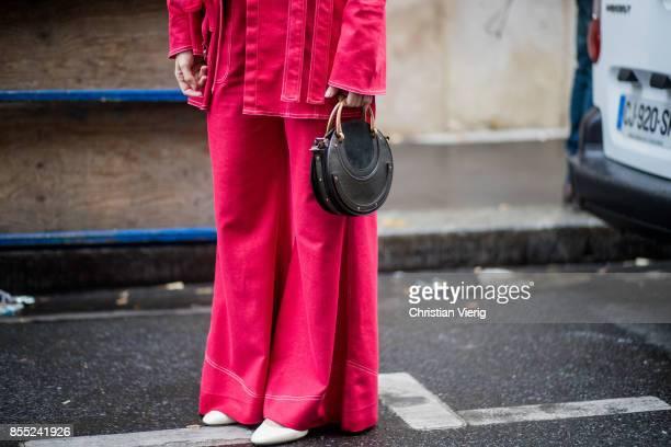 A guest wearing Chloe bag is seen outside Chloe during Paris Fashion Week Spring/Summer 2018 on September 28 2017 in Paris France