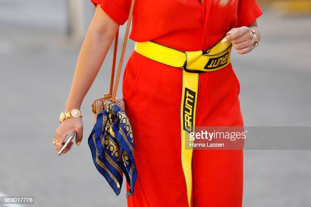 A guest wearing Christian Dior headband red dress and scarf bag during MercedesBenz Fashion Week Resort 19 Collections at Carriageworks on May 16...
