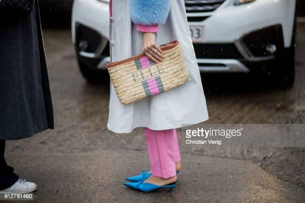A guest wearing clutch outside Cecilie Bahnsen during the Copenhagen Fashion Week Autumn/Winter 18 on January 31 2018 in Copenhagen Denmark