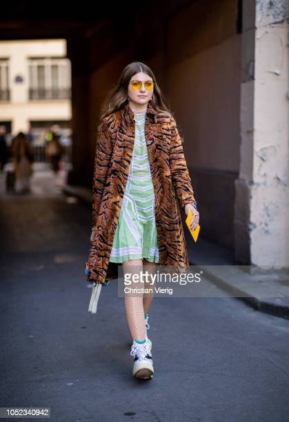 A guest wearing coat with animal print is seen outside APC during Paris Fashion Week Womenswear Spring/Summer 2019 on October 1 2018 in Paris France