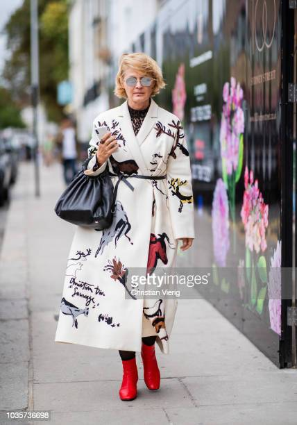 A guest wearing coat with print is seen outside Natasha Zinko during London Fashion Week September 2018 on September 18 2018 in London England