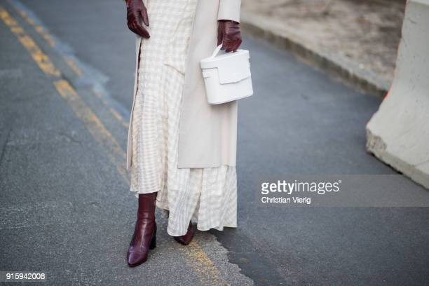 A guest wearing creme coat white bag seen outside Creatures of Comfort on February 8 2018 in New York City