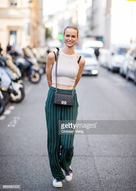 A guest wearing cropped blouse seen outside Fendi Couture on day four during Paris Fashion Week Haute Couture FW18 on July 4 2018 in Paris France