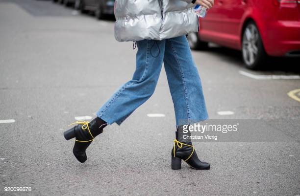 A guest wearing cropped denim jeans ankle boots seen outside Delpozo during London Fashion Week February 2018 on February 18 2018 in London England