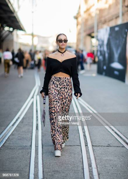 A guest wearing cropped off shoulder top pants with leopard print during MercedesBenz Fashion Week Resort 19 Collections at Carriageworks on May 15...