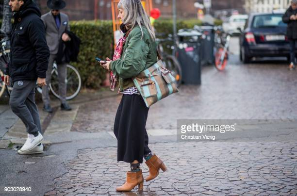 A guest wearing cropped pants leather boots bomber jacket is seen during the 93 Pitti Immagine Uomo at Fortezza Da Basso on January 9 2018 in...