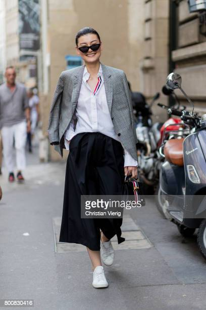 A guest wearing cropped pants outside Thom Browne during Paris Fashion Week Menswear Spring/Summer 2018 Day Five on June 25 2017 in Paris France
