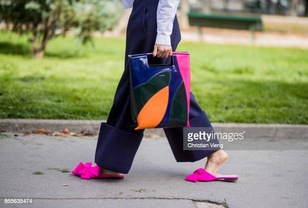 Guest wearing Delpozo bag is seen outside Issey Miyake during Paris Fashion Week Spring/Summer 2018 on September 29, 2017 in Paris, France.