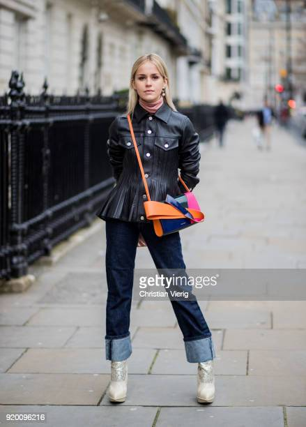 A guest wearing Delpozo bag seen outside Delpozo during London Fashion Week February 2018 on February 18 2018 in London England