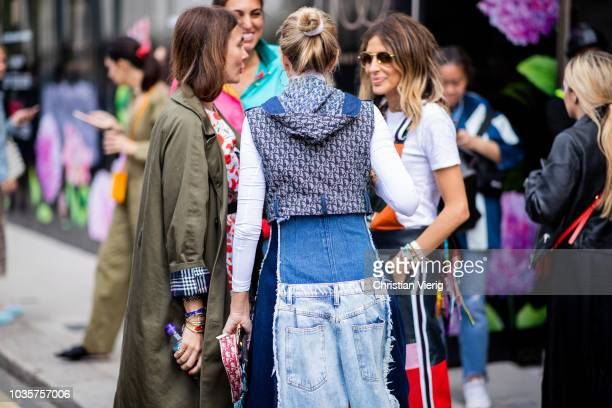 A guest wearing denim baggy overall cropped Dior jacket is seen outside Natasha Zinko during London Fashion Week September 2018 on September 18 2018...