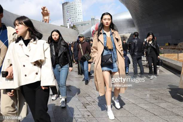 Guest wearing denim jacket and skirt trench coat and black leather bag is seen at the Hera Seoul Fashion Week 2019 F/W at Dongdaemun Design Plaza at...