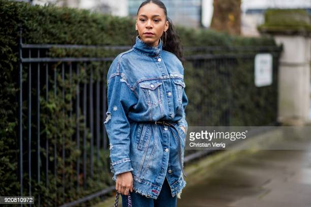 A guest wearing denim jacket cropped denim jeans Chanel bag seen outside Christopher Kane during London Fashion Week February 2018 on February 19...