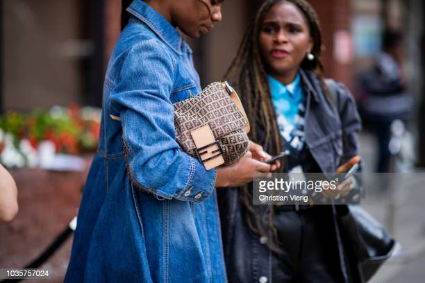 A guest wearing denim jacket Fendi bag is seen outside Natasha Zinko during London Fashion Week September 2018 on September 18 2018 in London England