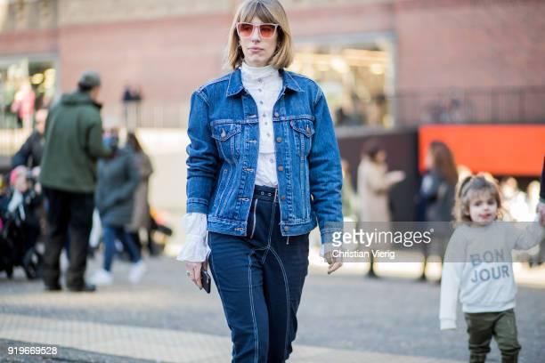 A guest wearing denim jacket seen outside Ports 1961 during London Fashion Week February 2018 on February 17 2018 in London England