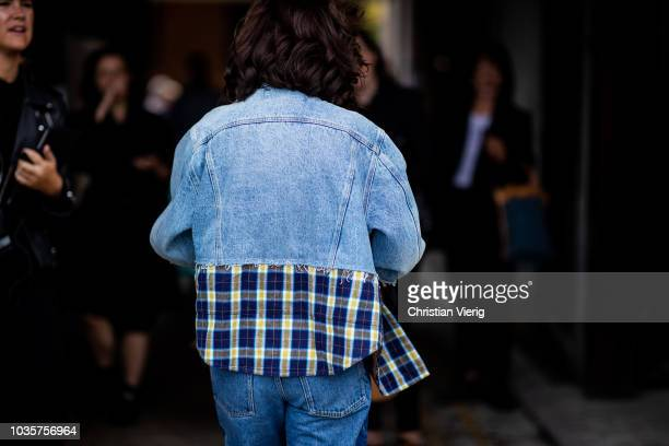 A guest wearing denim jacket with checked print is seen outside Natasha Zinko during London Fashion Week September 2018 on September 18 2018 in...