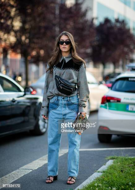 A guest wearing denim jeans belt bag is seen outside Palm Angels during Milan Men's Fashion Week Spring/Summer 2019 on June 17 2018 in Milan Italy