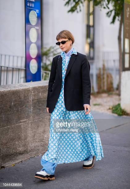 A guest wearing denim jeans blue dress black blazer is seen outside Sacai during Paris Fashion Week Womenswear Spring/Summer 2019 on October 1 2018...