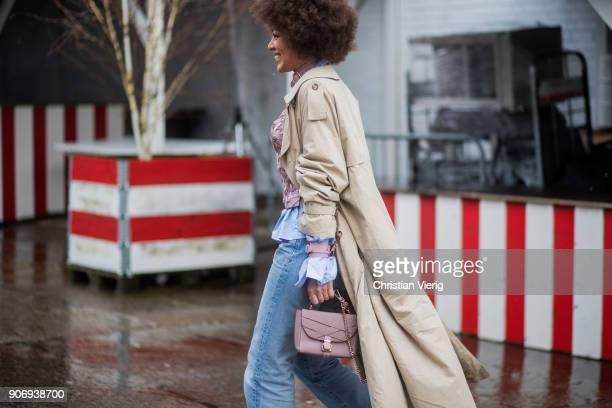 A guest wearing denim jeans Burberry trench coat is seen outside Marina Hoermanseder during the Berlin Fashion Week January 2018 on January 18 2018...