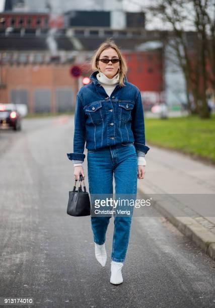A guest wearing denim jeans outside Munthe during the Copenhagen Fashion Week Autumn/Winter 18 on February 1 2018 in Copenhagen Denmark