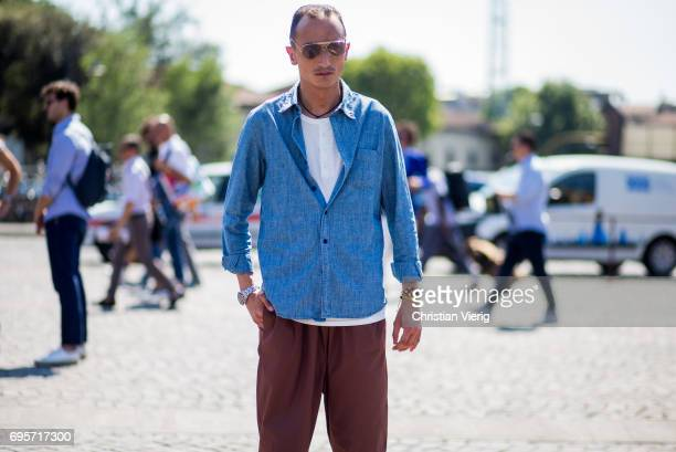 Guest wearing denim shirt is seen during Pitti Immagine Uomo 92. At Fortezza Da Basso on June 13, 2017 in Florence, Italy.